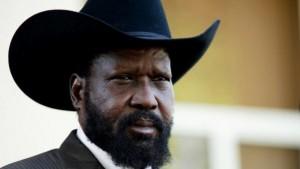 South Sudan leader Salva Kiir holds a pr