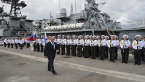 Russian President Vladimir Putin attends a welcoming ceremony as he inspects the Vice-Admiral Kulakov anti-submarine warfare ship in Novorossiysk
