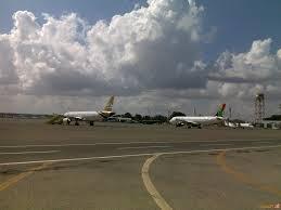 طائرة حربية تستهدف مطار معتيقة الدولي